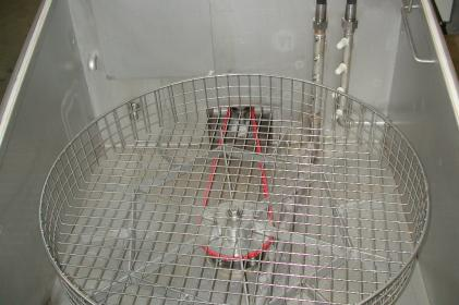 Rotating cleaning system for the cleaning of train engine parts